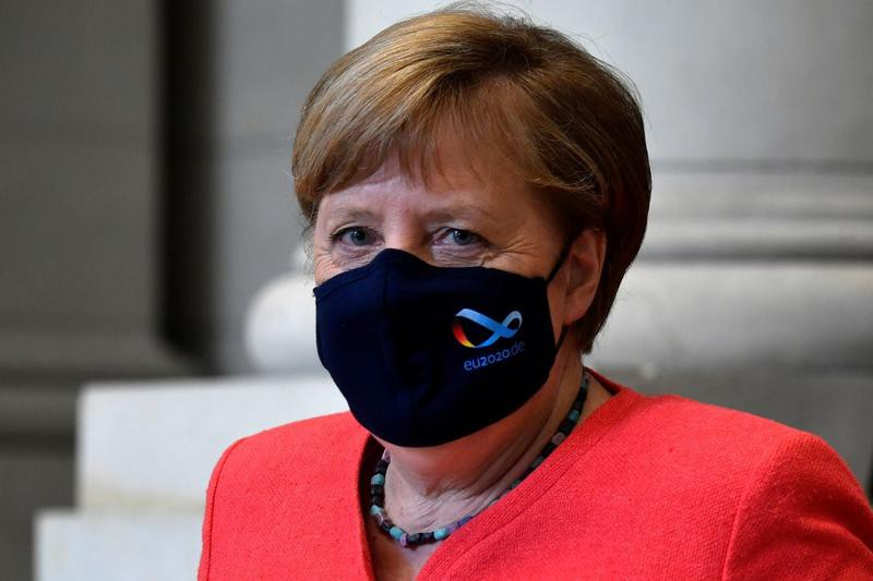 Coronavirus: Angela Merkel, deschisă ideii de a explora o colaborare cu Rusia pentru producţia de vaccinuri